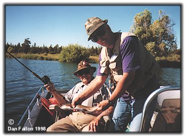 Dan Fallon (standing) and Walton Powell fishing on Fall River 1998